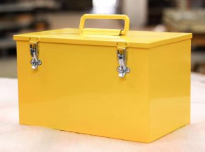 Large yellow box with handle and latches.