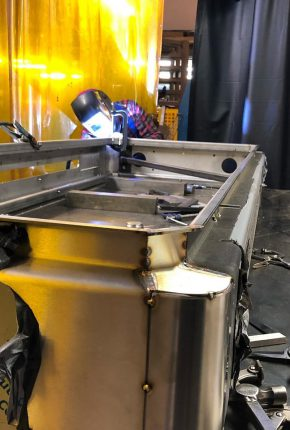 Welder TIG tacking large stainless cabinet